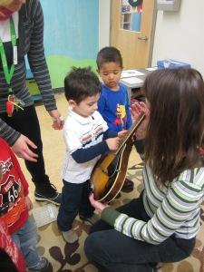 strumming the mandolin