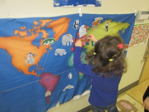 preschooler with flag map