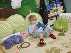 enjoying a book on Pajama Day