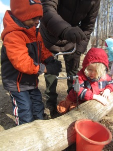 kids practice using the hand drill