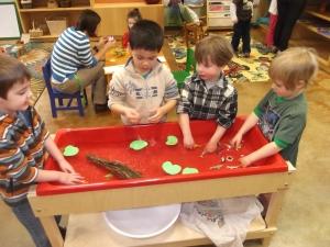 sensory table with tadpoles