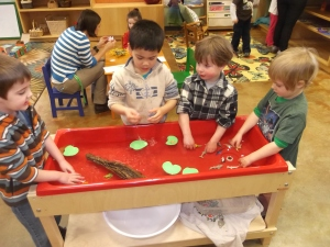 sensory table with tadpoles
