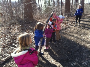 making a twig snake on the trail
