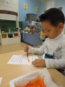 using vegetable paint to write letters